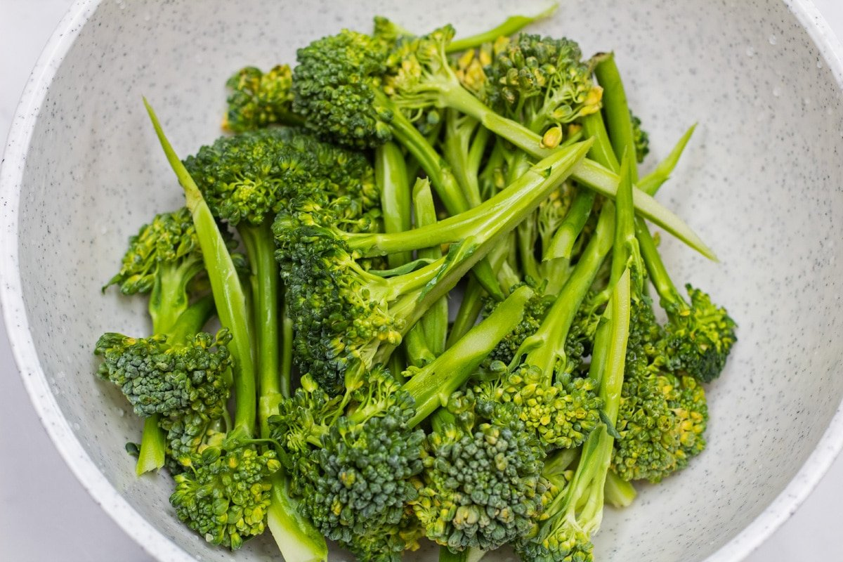 Broccolini washed and trimmed in bowl.