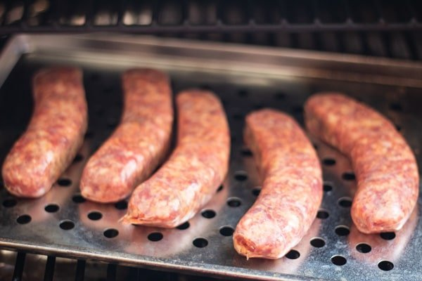 Process photo 1 of the Italian sausages while raw in the smoker.
