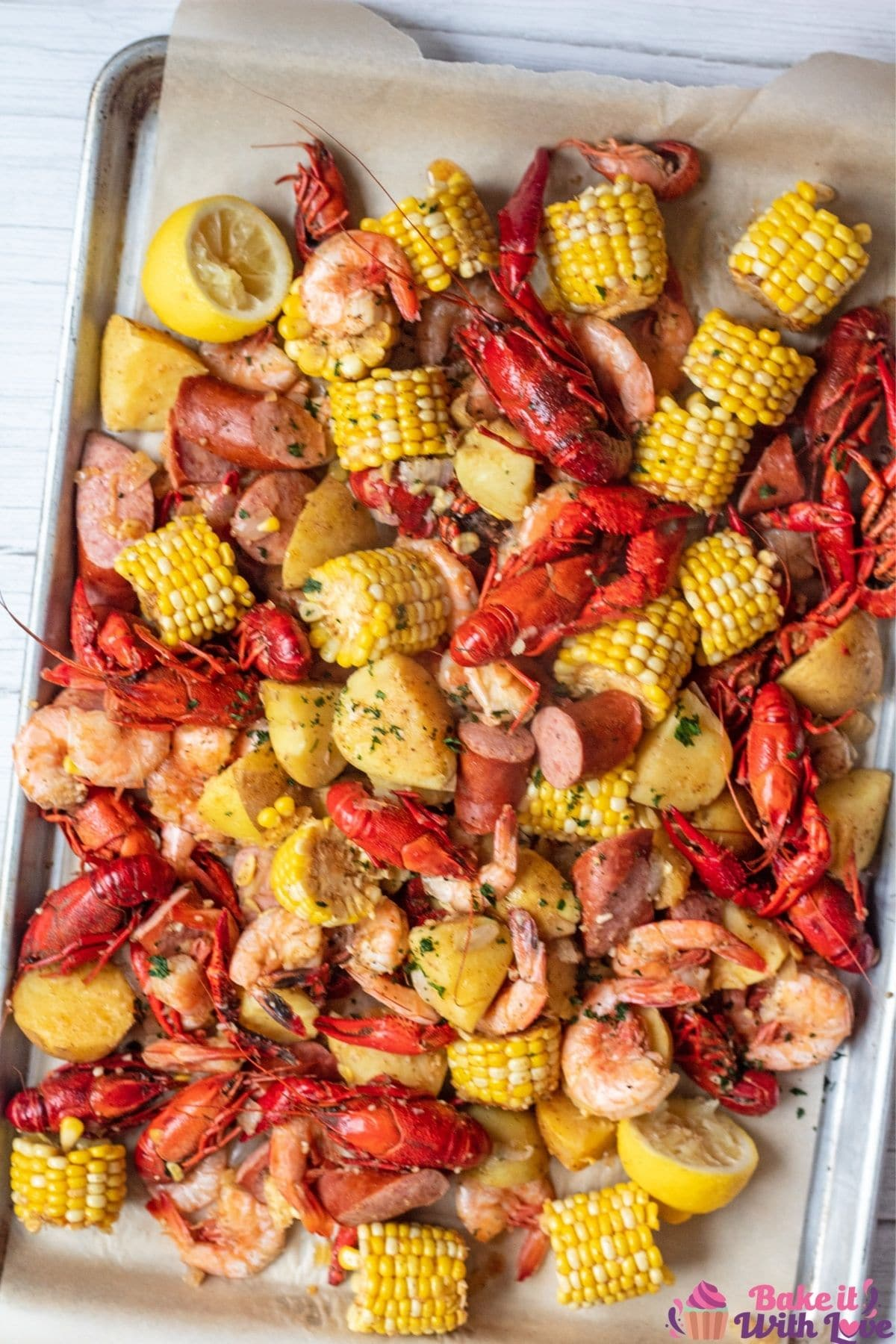 Tall overhead image of the cooked Cajun seafood boil.