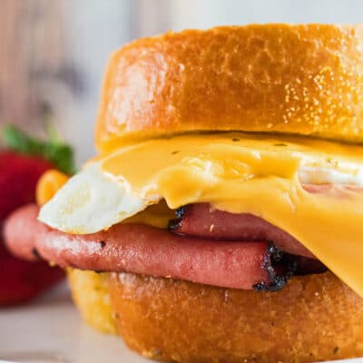 Close up image of a fried bologna and egg sandwich.