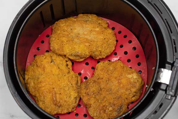 Process photo 2 of flipping the air fryer country fried steaks.