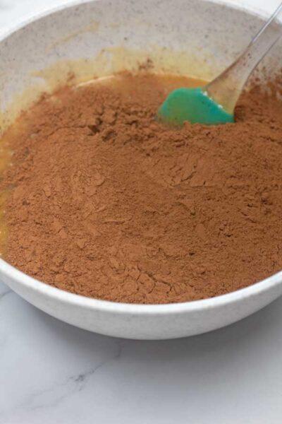 Process photo 4 adding sifted cocoa powder.