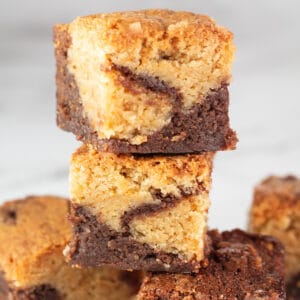 Brownie blondies stacked to show the tasty layers and marbling.