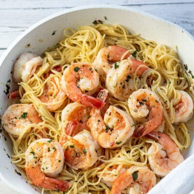 Square overhead of the lemon garlic shrimp pasta in white skillet.
