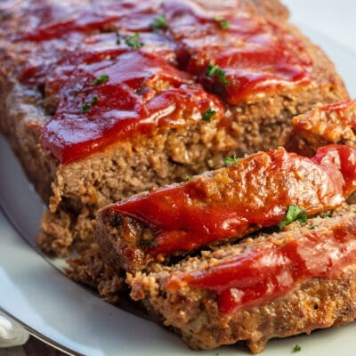 Lipton onion soup meatloaf sliced and ready to serve on platter.