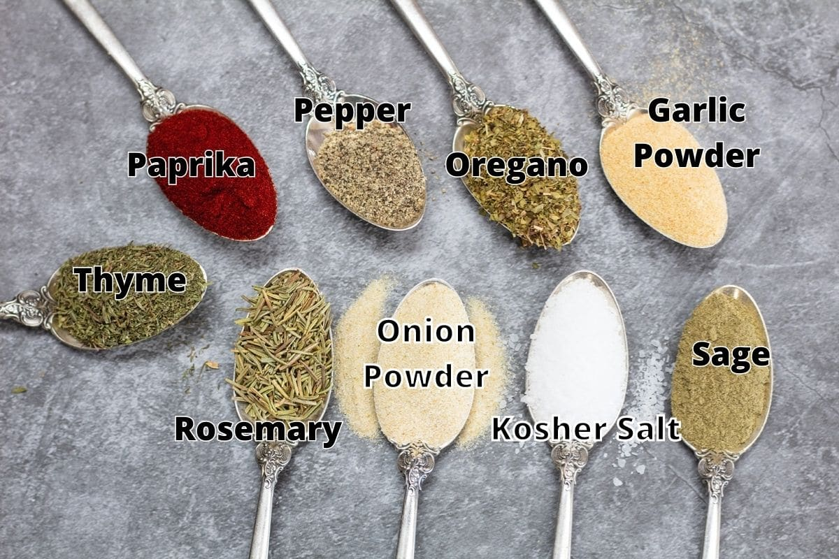 Prime rib rub ingredients in spoons with labels.