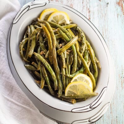 Oven roasted green beans in serving bowl.